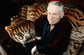 Hugh Hefner, CEO of Playboy Enterprises, poses for a photo during an interview with journalists at his mansion in Los Angeles.