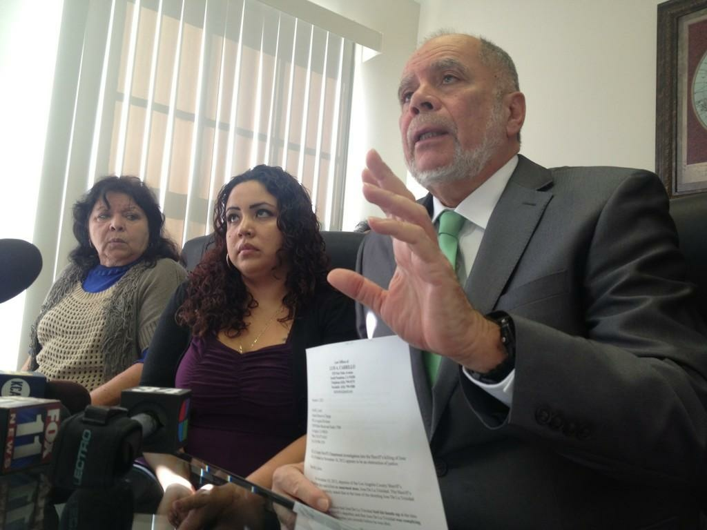 Attorney Luis Carrillo (right) sits with the family of the unarmed Jose De La Trinidada shot and killed by Sheriff's deputies to discuss a letter he wrote requesting an FBI investigation into the November shooting.