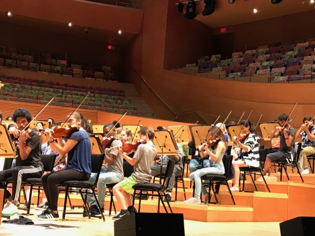 The Hollywood Bowl Orchestra's principal conductor, Thomas Wilkins, leads the National Take a Stand Festival Youth Orchestra in a rehearsal at Walt Disney Concert Hall.