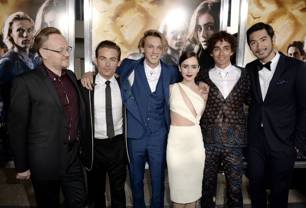 Actors Jared Harris, Kevin Zegers, Jamie Campbell Bower, Lily Collins, Robert Sheehan and Godfrey Gao arrive at the premiere of