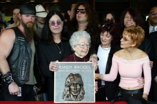 The mother of Randy Rhoads, Delores Rhoads, along with rockers (left to right) Zakk Wylde, Ozzy Osbourne, guitarist Yngwie Malmsteen and Sharon Osbourne attend the ceremony in which the late guitarist Randy Rhoads was honored posthumously and inducted into the Hollywood Rockwalk on March 18, 2004 in Hollywood, Calif.