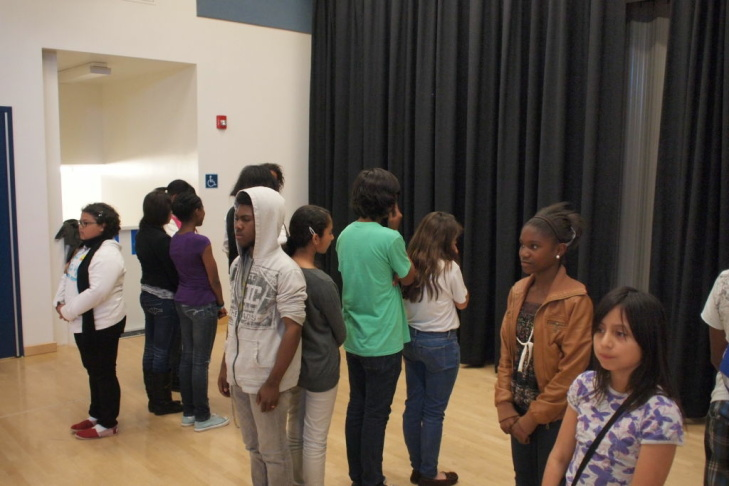 Dana Middle School students rehearsing for a play coordinated by Inside Out Community Arts