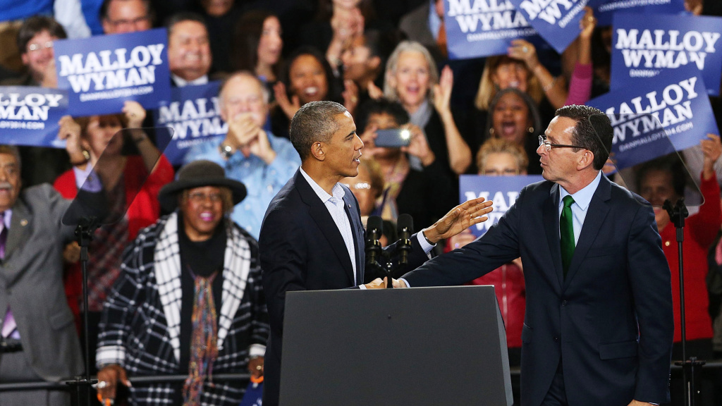 President Barack Obama stands with Connecticut Governor Dan Malloy in Bridgeport on Sunday. Malloy is in a tough re-election battle with Republican Tom Foley. The president spent the weekend trying to energize the Democratic base to get out and vote in Tuesday's middterm elections.