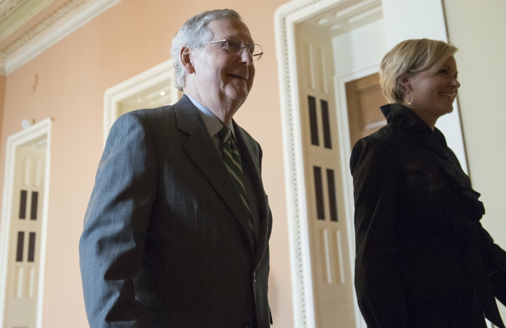 US Senate Majority Leader Mitch McConnell, Republican of Kentucky, walks through the US Capitol in Washington, DC, June 22, 2017, following the release of a draft of the Senate Republican's healthcare bill.