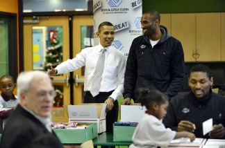 President Barack Obama chats with Los Angeles Laker Kobe Bryant as they pack gifts for troops at a Boys and Girls Club in Washington, D.C., on Dec. 13, 2010. Obama welcomed the Lakers to honor their 2009-2010 season and their second consecutive NBA championship.
