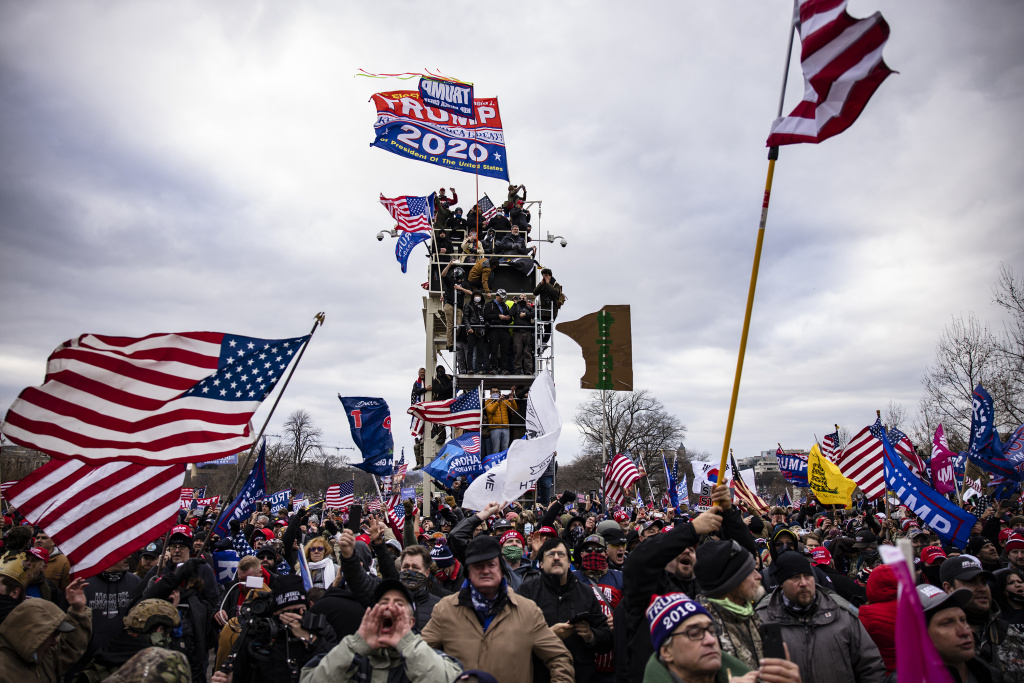 Pro-Trump supporters storm the U.S. Capitol following a rally on Jan. 6. So far, military veterans account for about 15 percent of those criminally charged in the Capitol riot, according to an NPR analysis.