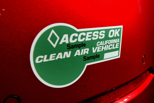Green stickers are offered to low-emission cars on a limited basis. Vehicles that run entirely on alternative fuel sources, such as fully electric cars, can be given white stickers. There's no limit on the number of white stickers given out by the Department of Motor Vehicles, but only 55,000 green stickers are on the road at any time.