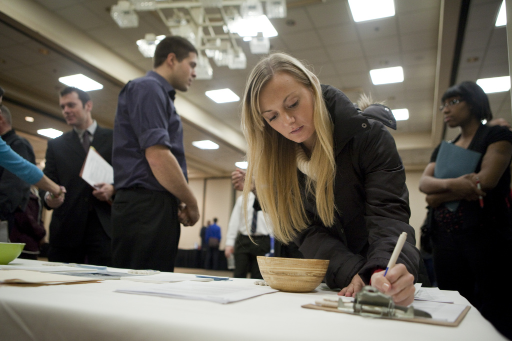 Intern Jenny Pazar fills out a form as she looks for a job at a job fair Dec. 2, 2011 in Portland.