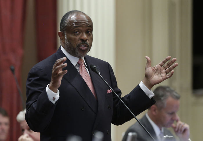 State Sen. Rod Wright, D-Inglewood, urges lawmakers to approve a bill that would require the state to hand out condoms at adult prisons, at the Capitol in Sacramento, Monday, Sept. 9, 2013.