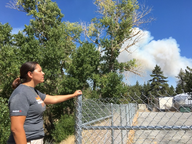 Resident of Wrightwood Nancy Martinez watches the smoke plume from the Blue Cut fire approach Wrightwood from the pacific crest, lone pine area.