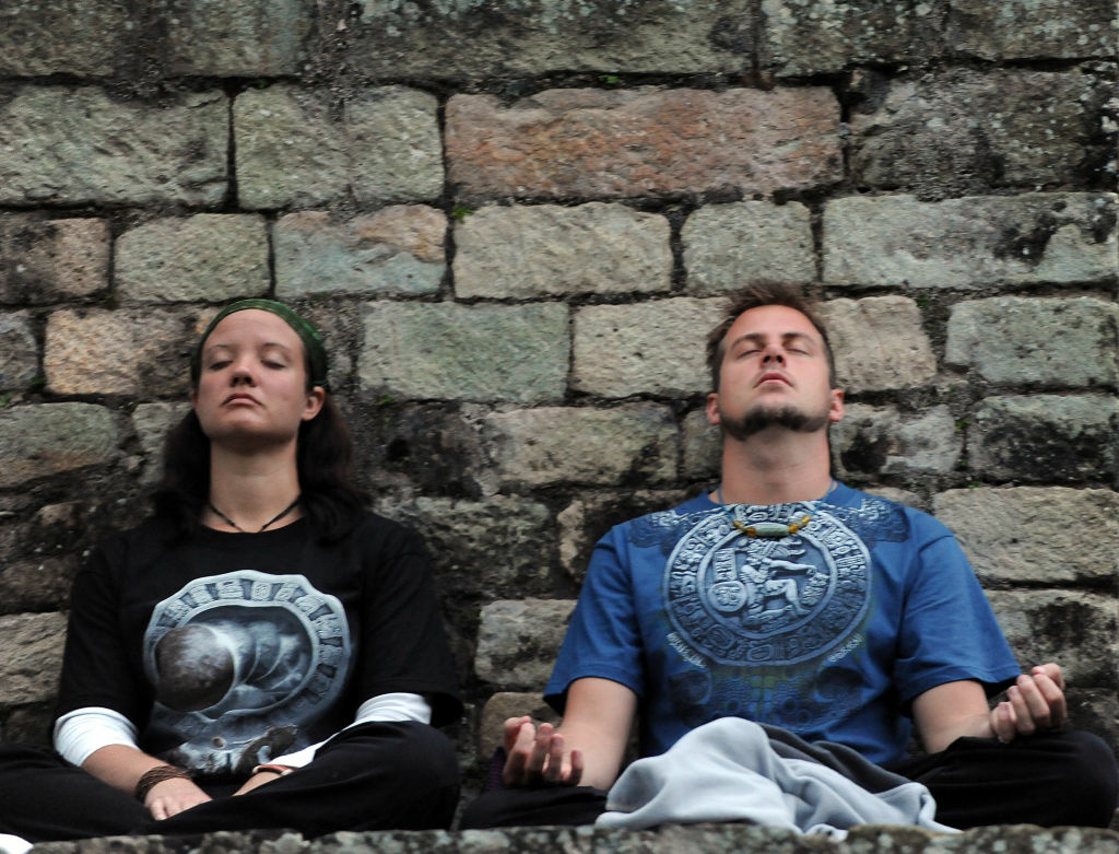 A couple meditates during celebrations for the end of the Mayan cycle known as Bak'tun 13 and the start of the Maya new age, on December 21, 2012, in the Copan archaeological park, 400km northwest of Tegucigalpa.