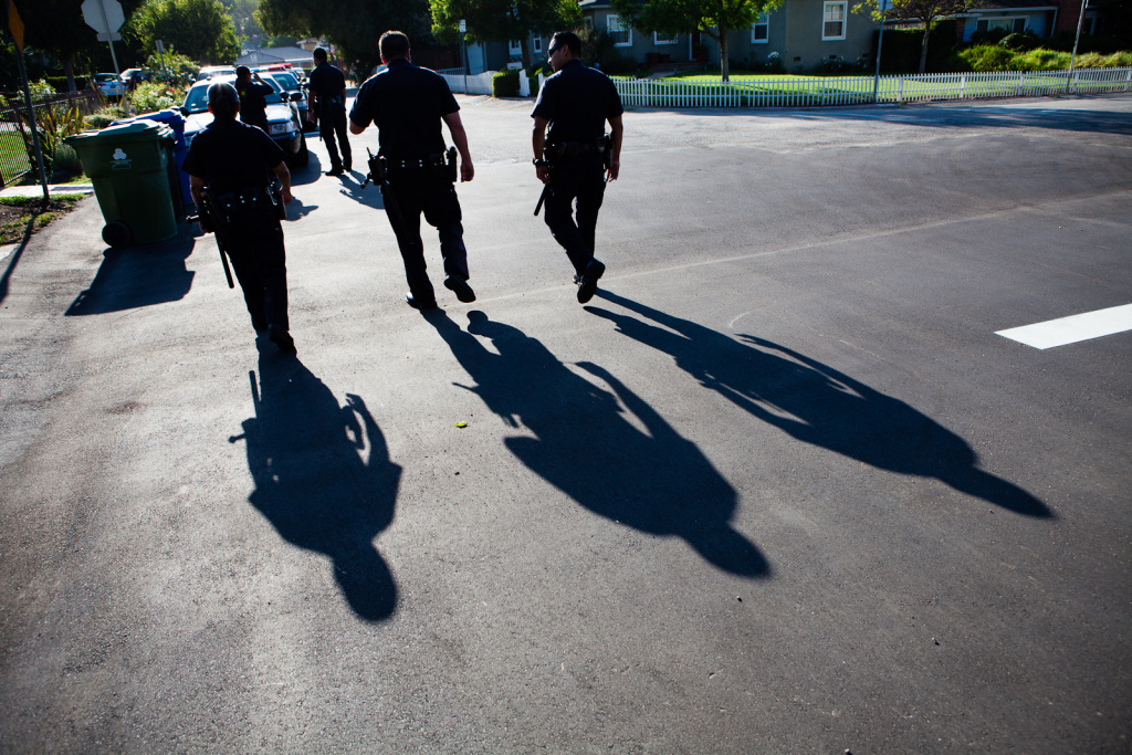 North Hollywood Police Department's  Probation Compliance Unit is currently monitoring about 110 former prisoners throughout the district. On August 21, 2012, the Unit traveled as a team of five - one sergeant, and three police officers, and another officer from the LA County Dept. of Probation.