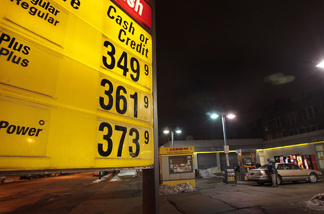 A gas station advertises gas in excess of $3 per gallon December 23, 2010 in Chicago, Illinois.