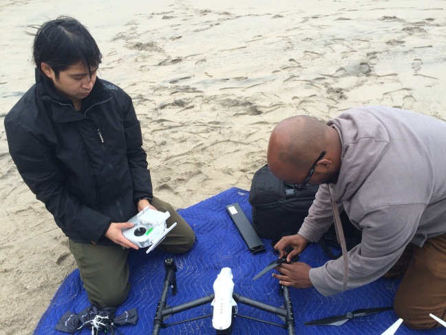 Brennon Edwards and Dominic Bendijo prepare the flight route for a drone they used to photograph the Malibu coastline on Jan. 15, 2016.