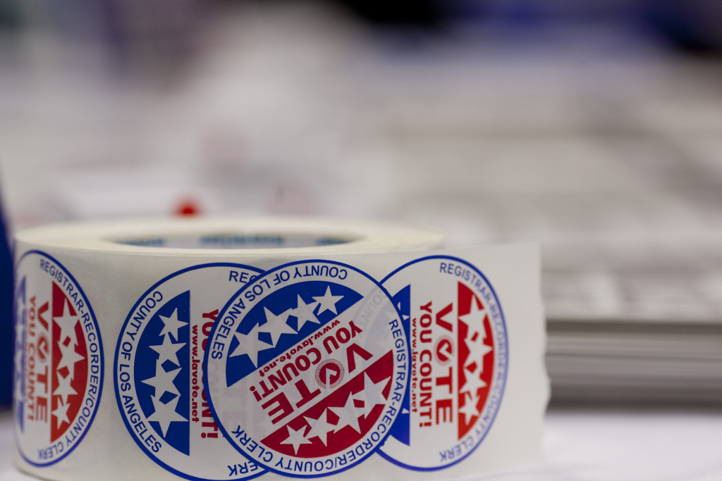 Photo shows the stickers given to newly naturalized American citizens after they registered to vote.