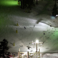 Skiers take advantage of well-lit slopes through the night at Mountain High ski resort, January 24, 2001 near Wrightwood, CA.