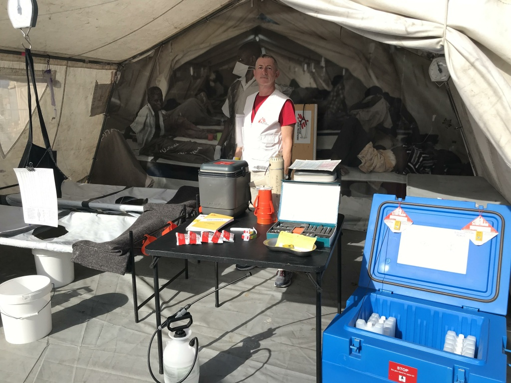 John Fiddler in front of the cholera tent at the