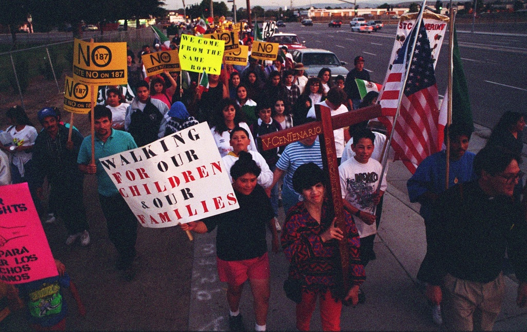 About 200 demonstrators protesting Proposition 187 march along Senter Road in San Jose on October 25, 1994. The march began in Morgan Hill and ended at St. Joseph's Cathedral in downtown San Jose.