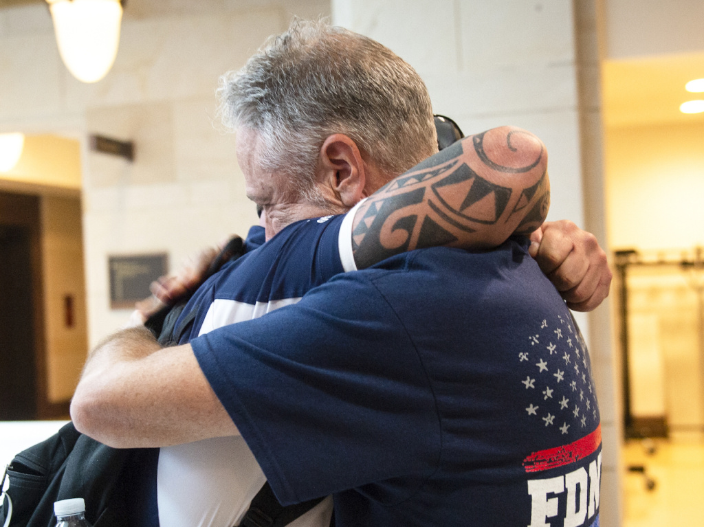 Sept. 11 first responder John Feal (left) and Jon Stewart, former host of <em>The Daily Show</em>, hug after the Senate passed a bill for extending the September 11th Victim Compensation Fund in Washington on Tuesday.