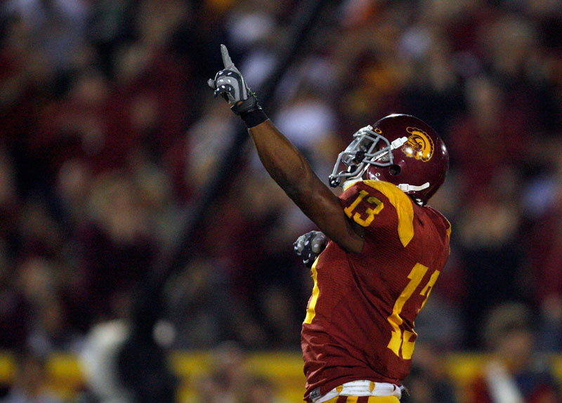 Stafon Johnson #13 of the USC Trojans celebrates his touchdown for a 7-0 lead over the Nortre Dame Fighting Irsh during the first quarter at the Coliseum on November 29, 2008 in Los Angeles, California.