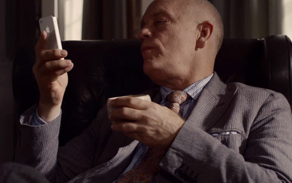 A screenshot from John Malkovich's new Apple iPhone commercial.