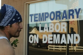 Unemployed father of two, Michael Lopez waits for work outside a temporary labor office in the Southern Californian town of El Centro, a town of 50,000 people where 30.4 percent of the work-age population are without employment, on October 28, 2010.