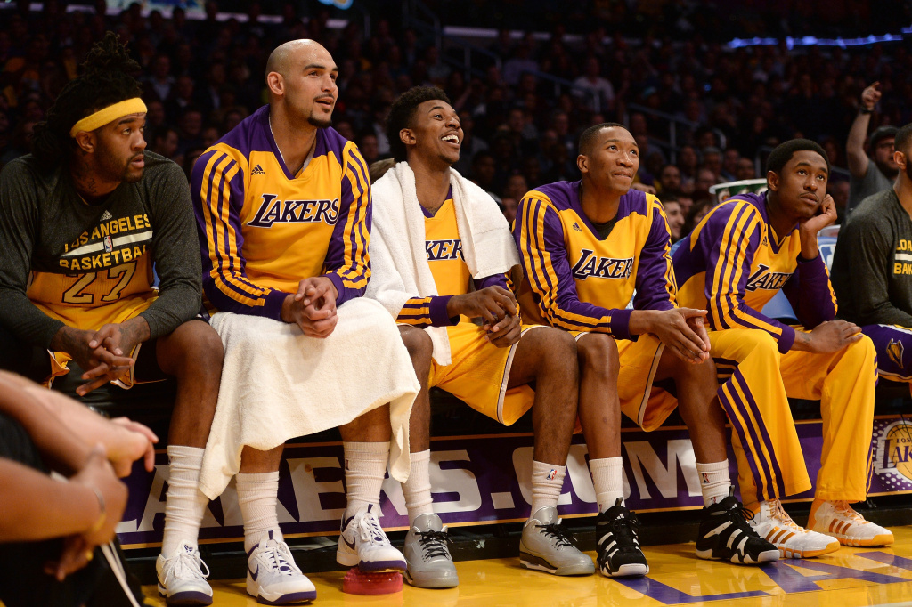 (L-R) Jordan Hill #27, Robert Sacre #50, Nick Young #0, Wesley Johnson #11 and MarShon Brooks #2 of the Los Angeles Lakers look on during a win over the New York Knicks at Staples Center on March 25, 2014 in Los Angeles, California.