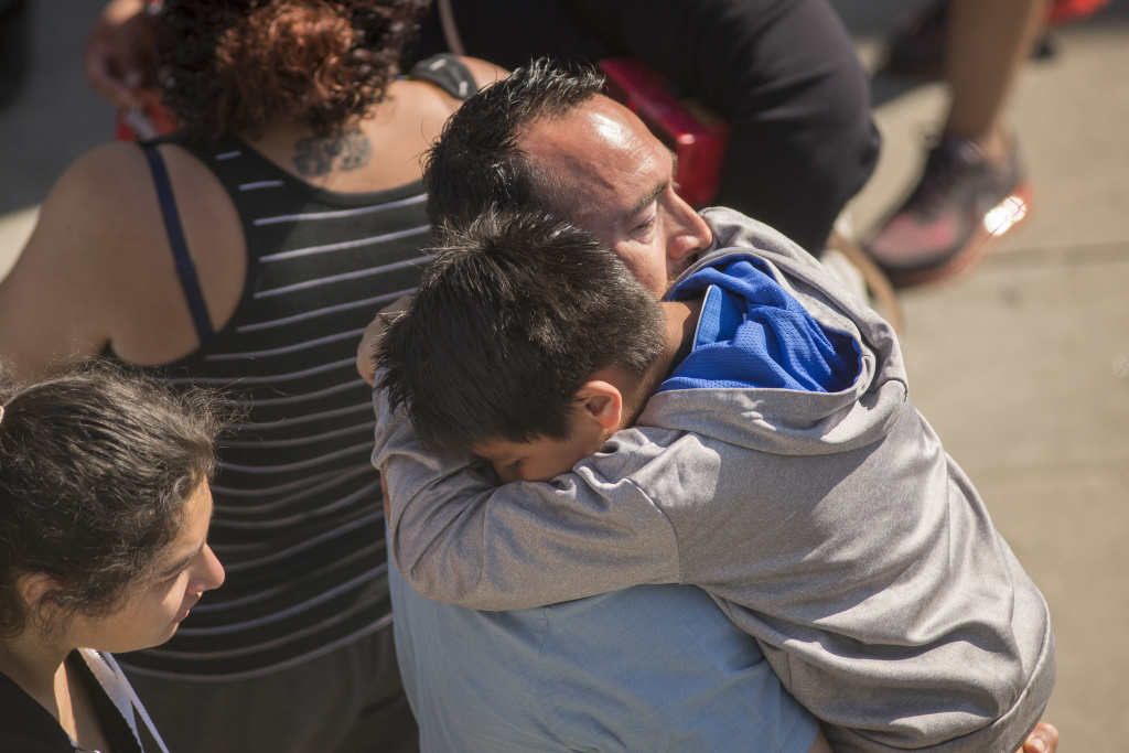 File: North Park Elementary School students and parents are reunited at Cajon High School after a shooting at their school on April 10, 2017 in San Bernardino.