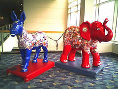 The elephant and donkey -- symbols of U.S. political parties -- are connected and share a veneer of similar advertising.