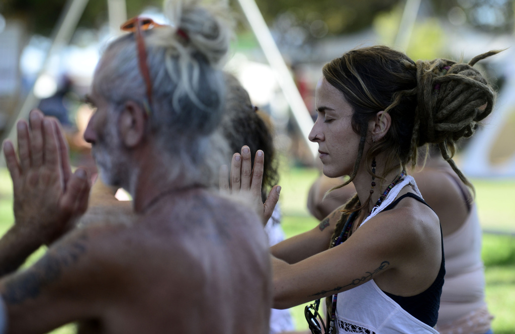 Participants practice yoga during a reggae restival in Benicassim, Spain on August 12, 2017.