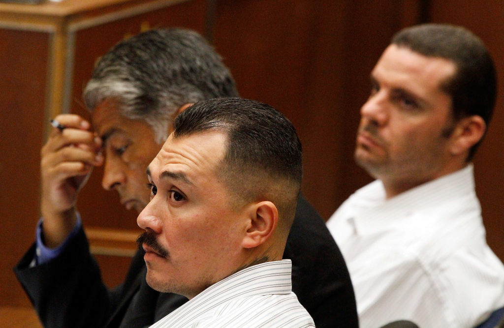 Defendants Louie Sanchez (foreground) and Marvin Norwood flank attorney Victor Escobedo during preliminary proceedings in Superior Court in June.