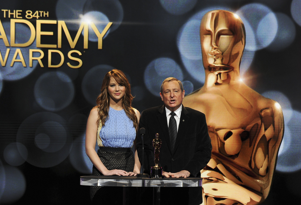 Actress Jennifer Lawrence and Tom Sherak, president of the Academy of Motion Picture Arts, announce the nominees at the 84th Academy Awards Nominations Announcement, January 24, 2012 at the Academy's Samuel Goldwyn Theater in Beverly Hills, California.  Martin Scorsese's lavish 3D adventure
