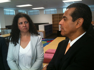Los Angeles Mayor Antonio Villaraigosa speaks to Ana Ponce, CEO of Camino Nuevo Charter Academy. The group will run one of dozens of new and low performing campuses free of school district control.