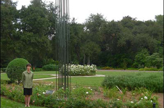 Huntington curator Jessica Smith, next to the 19-foot tall bronze