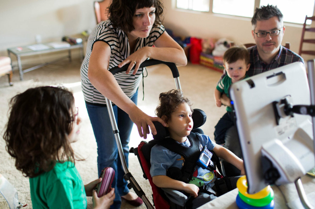 Gideon, 3, communicates with his parents Kathleen Muldoon and Seth Dobson, his sister Genevieve and brother Cormac, using an electronic device they call,