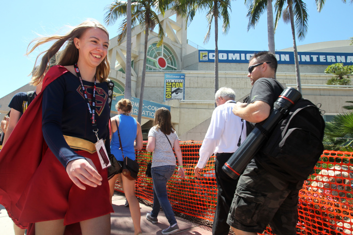 Tyler Greening of Albuquerque, New Mexico, dressed as Supergirl, careens past the San Diego Convention Center where the Comic-Con International 2016 is being held on July 21, 2016.