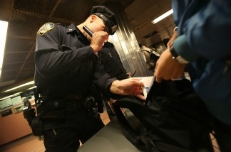 NYPD officers inspect a bag inside Grand Central Terminal.