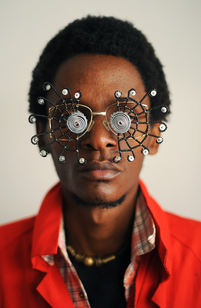 Kenyan artist Cyrus Kabiru poses with an artwork resembling sunglasses on February 1, 2012 in Nairobi. Kabiru has created a range of artworks called