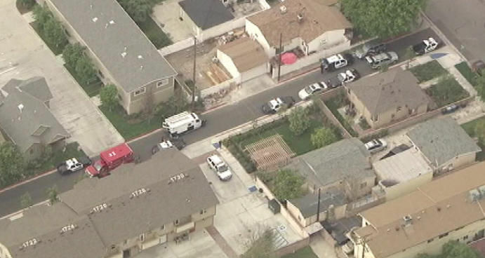 "A police vehicle outside a Burbank residence after officers responded to a ""shots heard"" call."