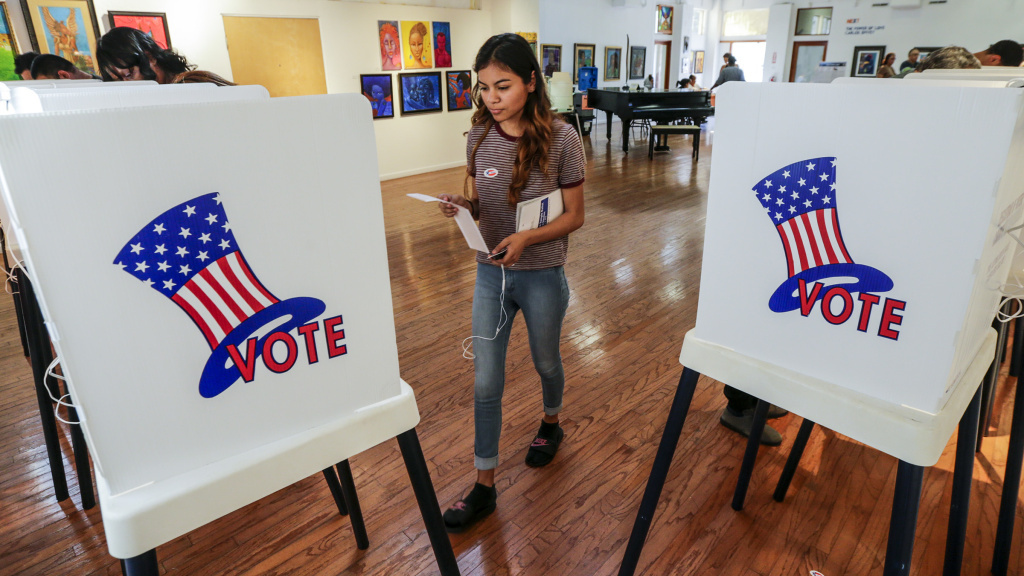 FILE PHOTO: Maryjane Medina, 18, a first-time voter, walks up to a polling booth to cast her vote at a polling station in Los Angeles, California.