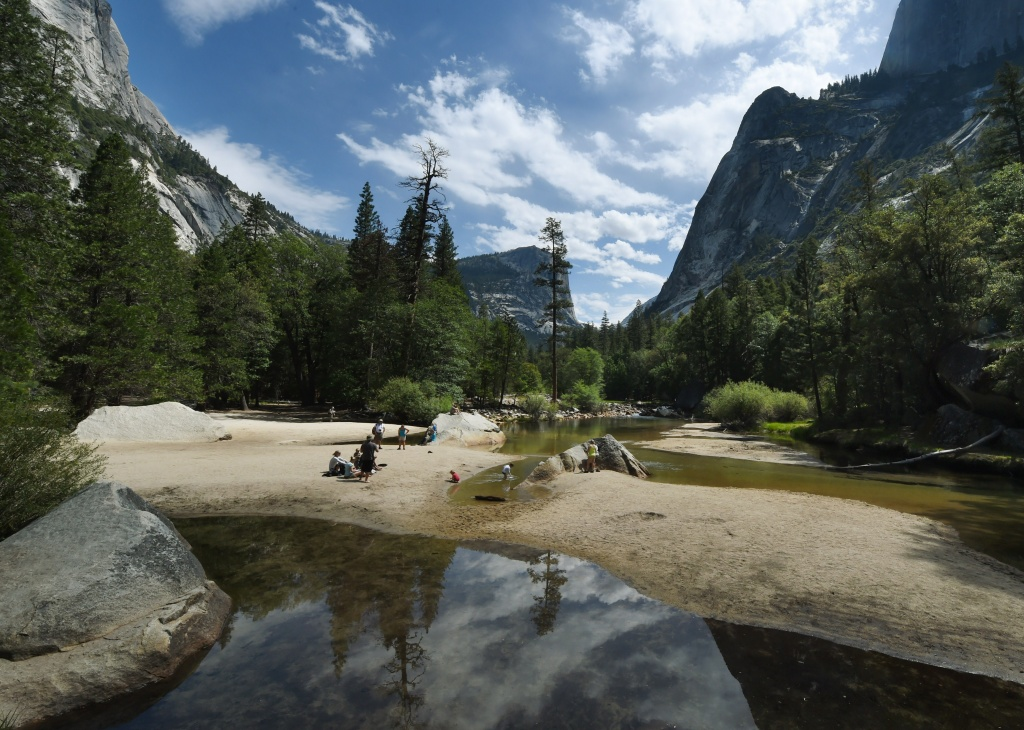 People picnic on the exposed sandy bottom of Mirror Lake, which is normally underwater and used by visitors to photograph reflections of Half Dome, on June 4, 2015.