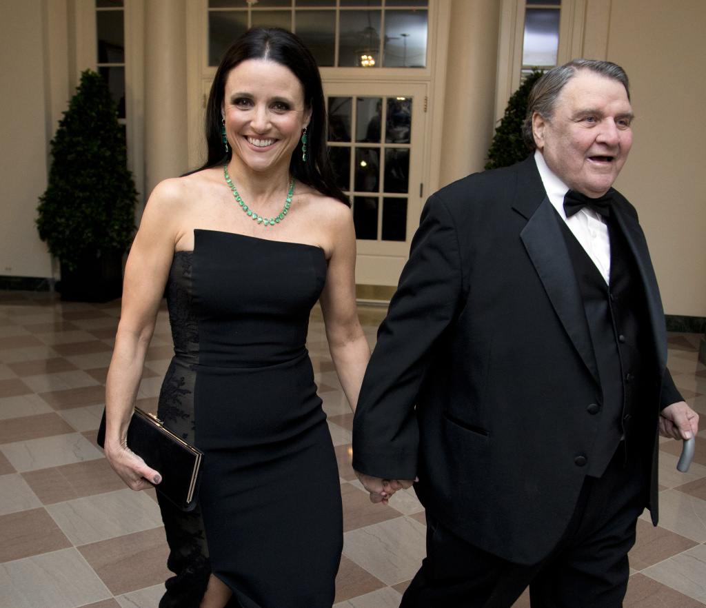 Actress Julia Louis-Dreyfus arrives for the White House State Dinner in honor of French President François Hollande, with her father, William Louis-Dreyfus.