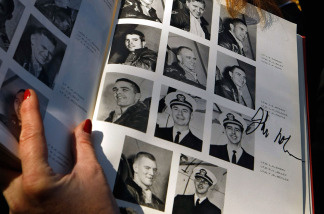A USS Intrepid yearbook from 1962 where a photo of Sen. John McCain appears.