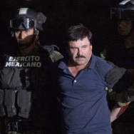 "After he was recaptured from breaking out of a maximum security prison in Mexico, Mexican drug lord Joaquin ""El Chapo"" Guzman is escorted by army soldiers to a waiting helicopter on Jan. 8."