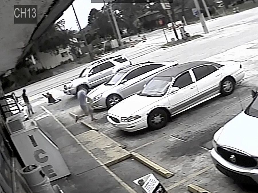 This image taken from surveillance video released by the Pinellas County Sheriff's Office, shows Markeis McGlockton, far left, and Michael Drejka involved in an altercation in the parking lot of a convenience store in Clearwater, Fla. on July 19.