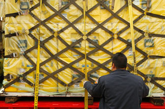 Los Angeles County Fire Department urban search and rescue team members load US Agency for International Development supplies to be flown to Haiti in the aftermath of the magnitude-7 earthquake onto truck on Jan. 13, 2010 in Pacoima, California.
