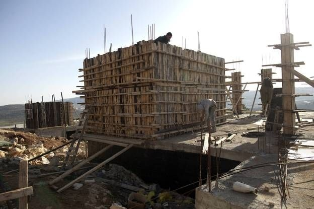 Workers construct new houses in the Jewish settlement of Shilo in the West Bank, back in February.