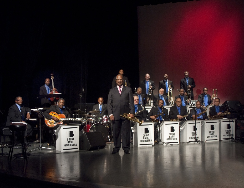 Scotty Barnhart, center, leads the Count Basie Orchestra
