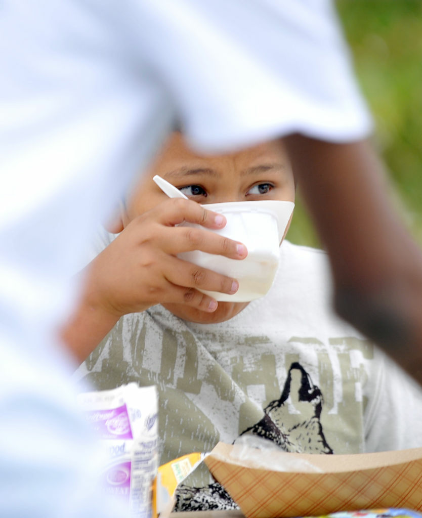 A student eats his cereal during breakfast period at Brockton Avenue Elementary School in Los Angeles.