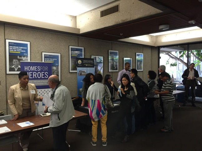 Workers from non-profit organizations talk with area landlords at a Department of Veterans Affairs event at UCLA. The VA wants more landlords to offer leases to homeless veterans with housing vouchers.